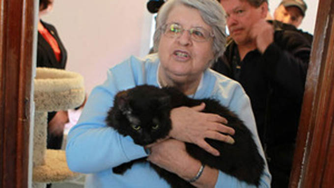 Boots arrives at her new digs in the arms of Sister Marijon Binder (Photo credit: Chicago Tribune)