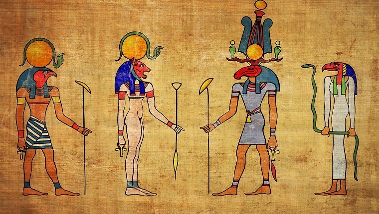 A painting of four Egyptian gods with animal heads on papyrus.