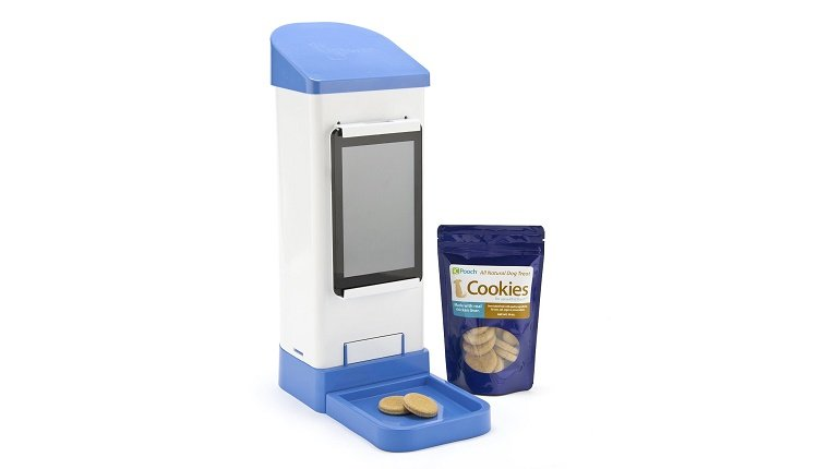 A tall treat dispenser has a package of dog cookies next to it.