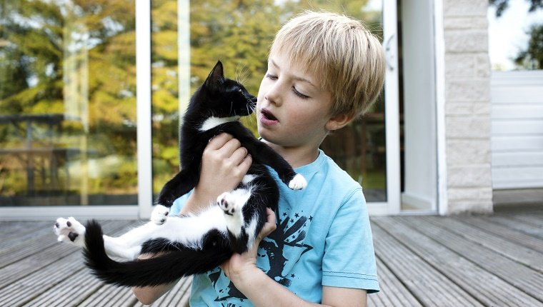 Boy with pet cat