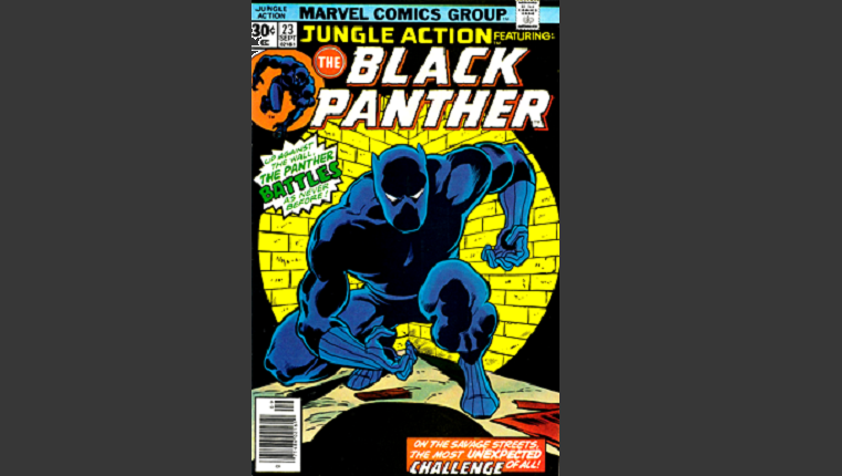 Black Panther crouches in front of a brick wall