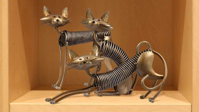 Metal cat coil sculpture